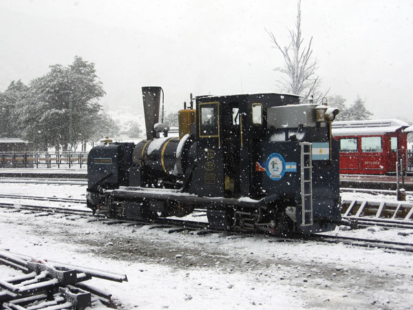 Snow in the summer! FCAF No.2 stands in the yard at Estacion Fin del Mundo during some unseasonal snow. 28 December 2008. © Chris Parrott