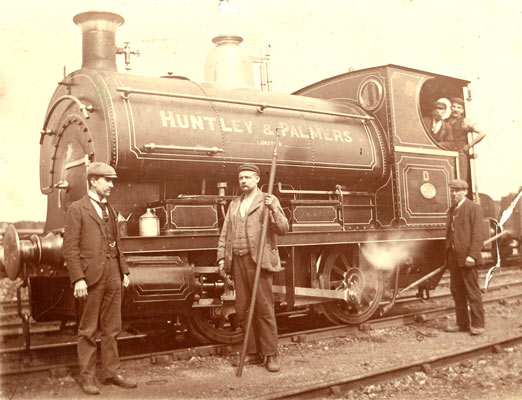 No.832 of 1900. Huntley and Palmers Ltd, of Reading, Loco D (locos had letters rather than numbers at this firm) and staff pose for the camera. The bearded gent on the loco, the driver, is known to be Henry Tollervey. The locomotive is believed to have eventually moved to a number of new operators finally ended up at New Cransley Iron and Steel of Kettering. Thanks to Geoff Pethick for the information on this loco. Photo courtesy of Roger Tollervey.
