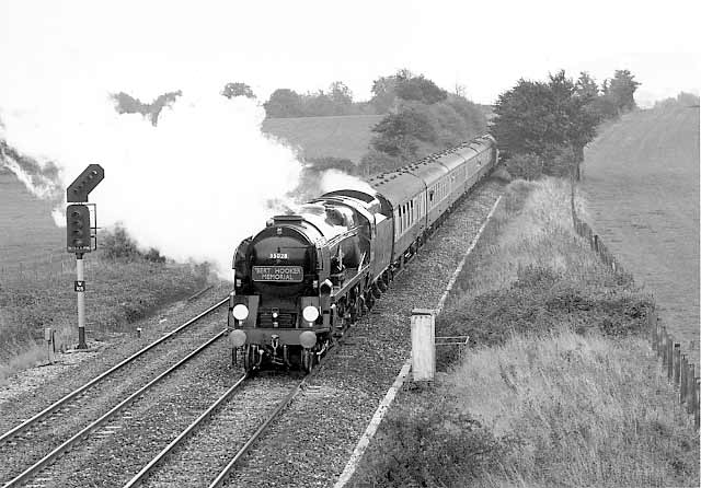 35028 Clan Line nears Fairwood Junction with the 'Bert Hooker Memorial' October 1996.