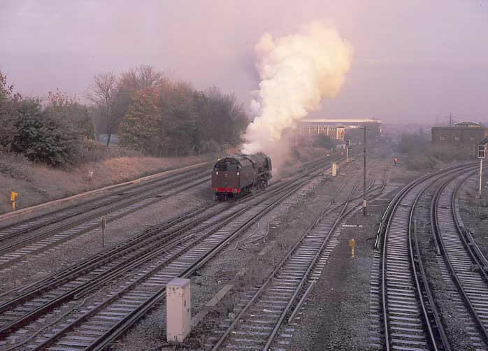 46229 Duchess of Hamilton on the Waterloo mainline at Guildford in preparation for the day's work. November 16 1996