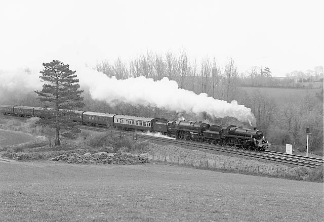 75014 and 70000 Britannia race up Whiteball bank. April 8 1995