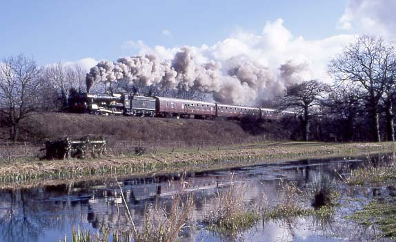 7802 Bradley Manor climbs towards Whiteball Tunnel at Burlescombe. March 16 1996