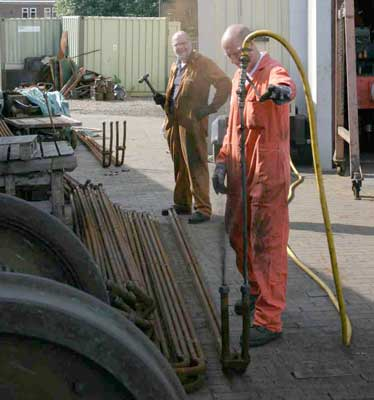 Steve Underhill use compressed air to blow muck out of the superheater elements assisted by Colin 'The Hammer' Henderson. September 04 2004. © Huw Button