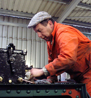 John Salter cleans some of the lubrication pipe work. December 21 2003