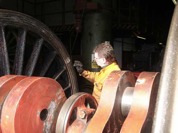 Kevin Blake prepares the rear of the wheel for priming. Note the white lines used to detect tyre slippage. March 23 2003 © Martyn Bane