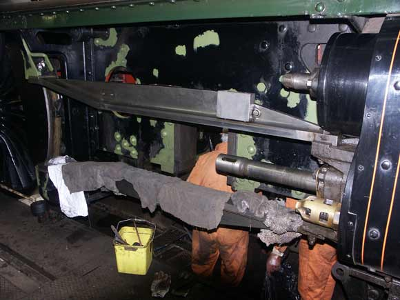 Proof the crank axle is out of the frames ! Just visible are parts of Tyseley's wheel drop. Note also the piston rod and the rags protecting the slide bar surface. March 23 2003. © Martyn Bane