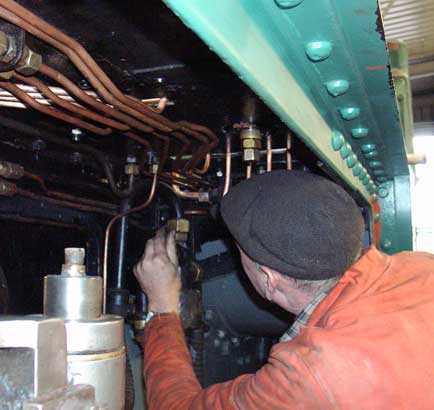 Steve Underhill works on the lubrication pipework. December 14 2003