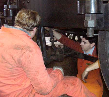 Stuart Nelhams (left) and Richard Abbey during the removal of the worn out tender brake blocks. December 14 2003