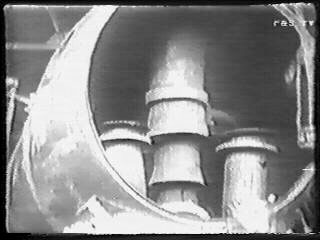 A view (taken from video) showing the partially completed smokebox arrangement. Central is the Kylchap exhaust, to either side are the mainsteam pipes which both lack their top sections connecting to the superheater header. 1949