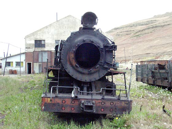 RFIRT 115 is dumped behind the loco depot facing towards the town, as most of the locomotives are. Missing a few parts it appears to be leaning over some what ! January 23 2004